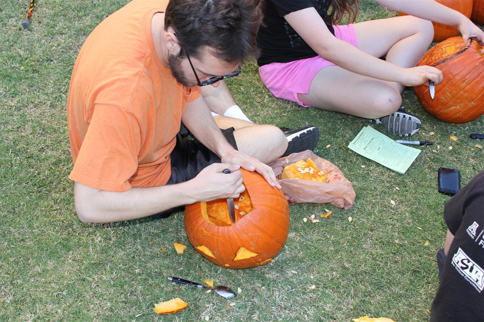 Abe carving a jack-o-lantern
